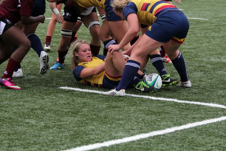 Jordyn Rowntree fights for possession against McMaster.
