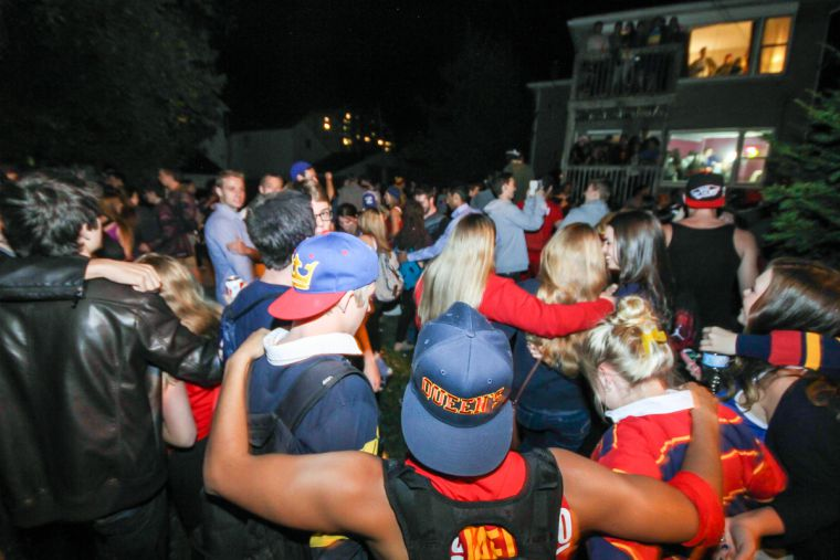 Partygoers do the Oil Thigh on Aberdeen St.