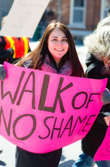 "A marcher reverses the ""walk of shame"" into a ""walk of no shame""."