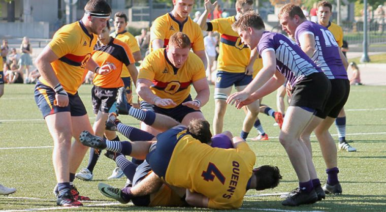Queen's forwards looking to push the pace with a won ruck.