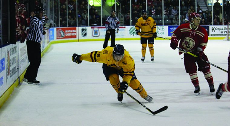 Forward Alex Row chases the puck into RMC's end.