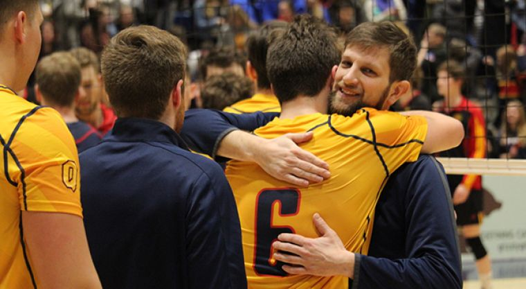 Gabriel DeGroot hugs Zane Grossinger after Saturday's five-set win.