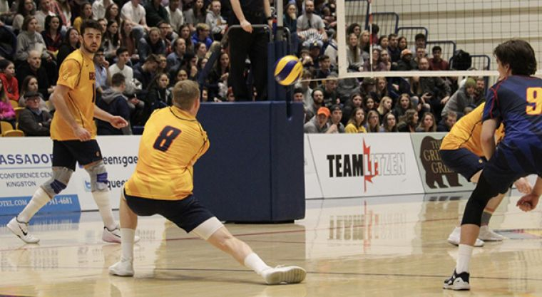 Outside hitter Joel Rudd bumps the ball to set up a play for the Gaels.