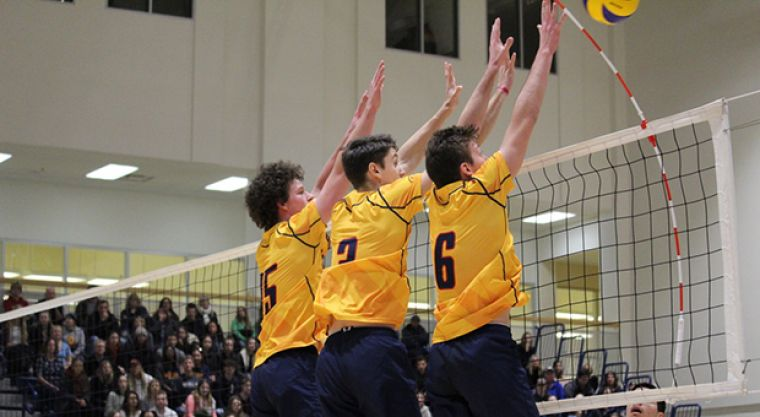 (Left to right) Zac Hutcheson, Dylan Hunt, and Zane Grossinger jump to defend against Guelph's attack.