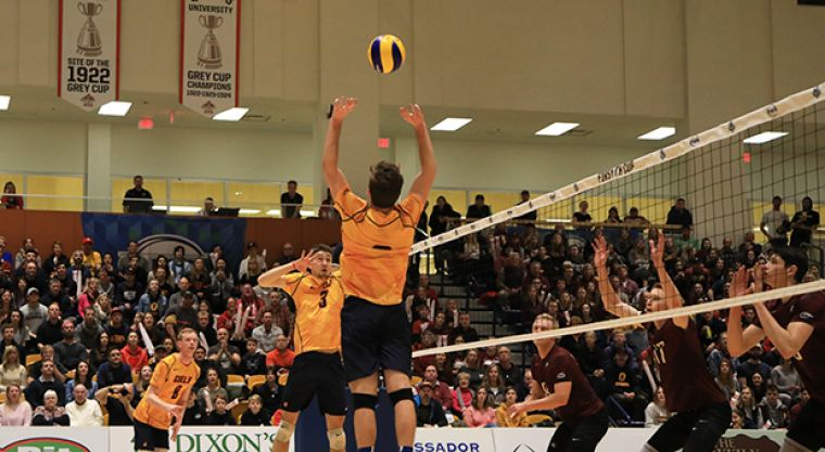 Zane Grossinger sets the ball as Joel Rudd (8) prepares to spike.