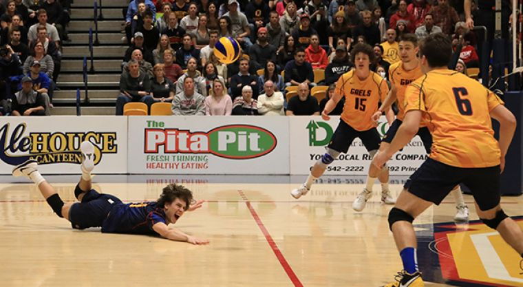 Third-year Lucas Kaufman makes a last-second dig to keep the point going.