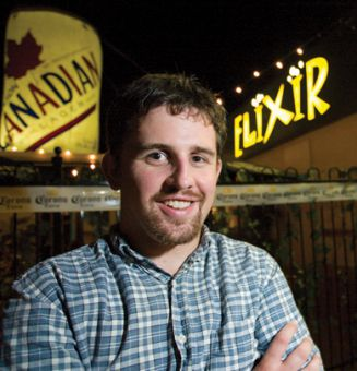 Chris Morris stands in front of Elixir, the venue for most of Rock Crew's shows
