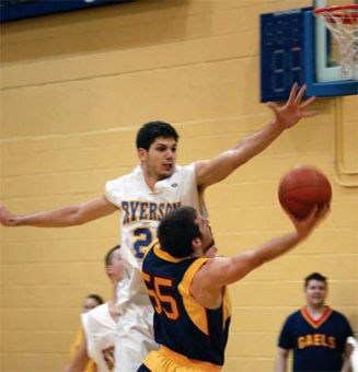 Baris Ondul aims for the basket against Ryerson on Saturday at home.