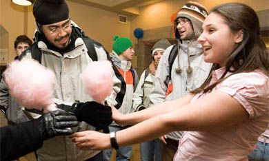 Team TPC's Vice-President (University Affairs) candidate Liz Craig, right, handed out cotton candy during the last day of campaigning yesterday. Voting takes place today and tomorrow.