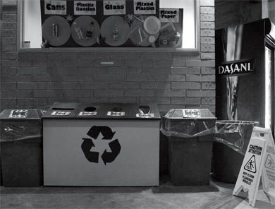 Initiatives like the display at the Common Ground instruct students on how to sort their recycling.