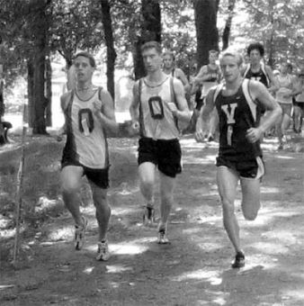 Queen's runners Travis Saunders, left, and Chris Hart compete at McGill on Saturday.