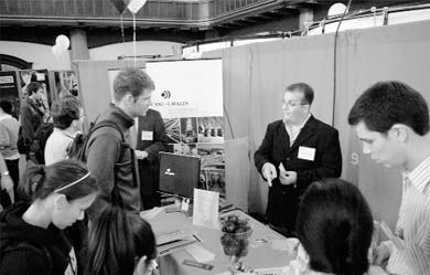 Students and prospective employers meet and greet at a Career Fair in Grant Hall yesterday.