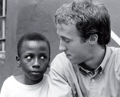 Craig Kielburger talks with a child as part of his work with Free The Children.