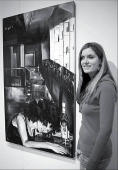 Nathalie Lawrence, BFA '07, stands with one of her paintings from the Saturnalia series.