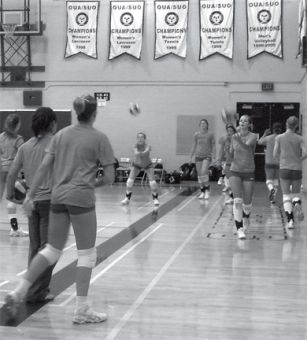 The women's volleyball warms up before their match against the University of Toronto.