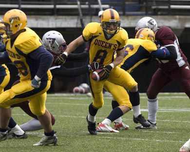 Queen's receiver Rob Bagg breaks a tackle during Saturday's semifinal in Ottawa.
