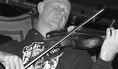 A member of the Toronto based Hidden Cameras fiddles with the ambience of the band's set.