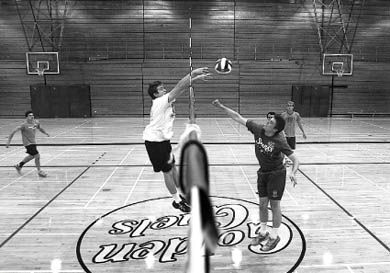 Men's volleyball players at a recent practice in Bartlett Gym. The team will have six new recruits this year.