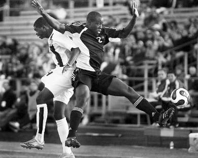Canadian defender Nana Attakora-Gyan (2) and American midfielder Anthony Wallace battle for position in the June 6 match.