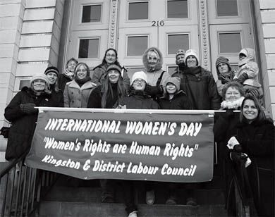 Women marched from St. Andrew's Church to City Hall yesterday to celebrate International Women's Day.