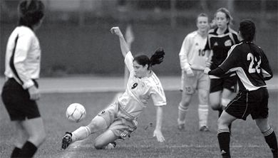 Eilish McConville fights to keep the ball in bounds in B.C.