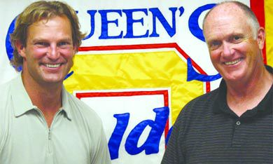 Former NHL star Kirk Muller shakes hands with Chair of Queen's Athletics John McFarlane. On June 17 it was announced Muller would join the Gaels as the new men's hockey coach.