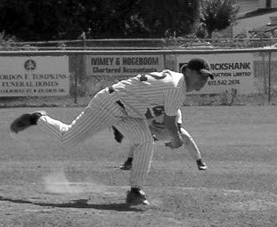 A member of the Queen's pitching staff follows through.