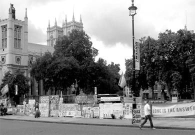 Signs of protest confront visitors as they leave London's Parliament Buildings.