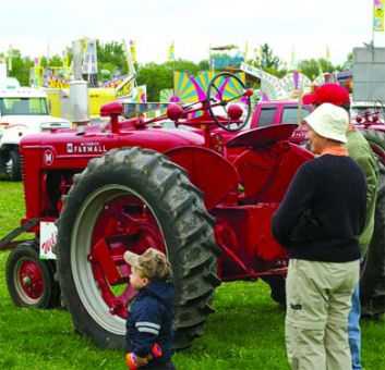 The antique tractors were a big pull for the many children who attended the fair.