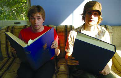 Nich Worby and Devon Lougheed of Tomate Potate take a break from their rigorous practice schedule with some quality reading material.