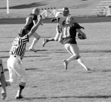 Gaels receiver Brad Smith heads downfield en route to 210 yards receiving.