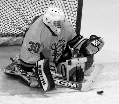 Gaels goaltender Claire Hunt tracks the puck against Western.