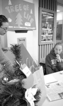 Shannon Mullen, PhysEd '07, and LolaJean Gentles, PhysEd '08, man the table for the Tree of Life charity at the PEC. CESA is also accepting donations at the JDUC.