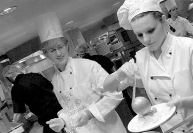 Christina Stubbs and daughter Erica, ArtSci '09, cook together in Leonard caf.