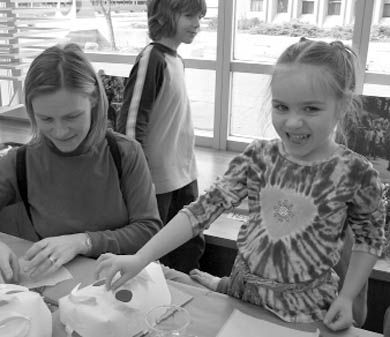 Martina Green and her daughter Erin get crafty with masks.