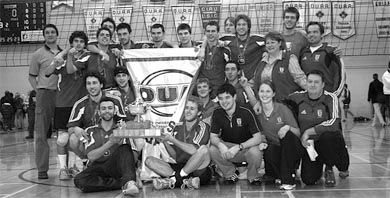 Men's volleyball celebrates their OUA championship in Bartlett Gym.