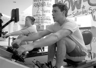 Queen's rowers count down as they pull towards the final hours of their 24-hour row-a-thon in the JDUC.