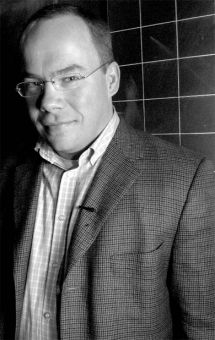 Maclean's columnist Paul Wells looked sharp and spoke sharply in Stirling Hall on Tuesday.