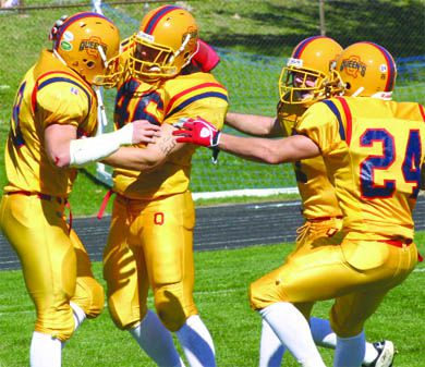 The Gaels defence celebrates a stop—in traditional gold—on Homecoming Saturday.