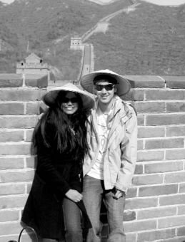 Maria Carvalho and Dave Grant stop for a photo as they climb the Great Wall of China.