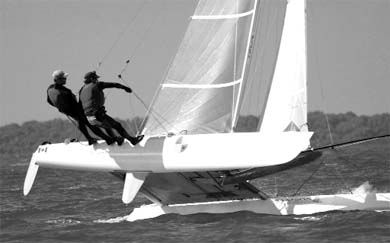 Johansson (left) and Curtis (right) get a lift from the wind and long-time friend Cowan.
