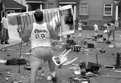 Participants in the appliance toss, the flagship event of Saturday's Aberdeen Olympics, lay waste to the Ghetto street.
