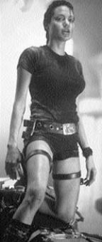 Jolie with her guns.
