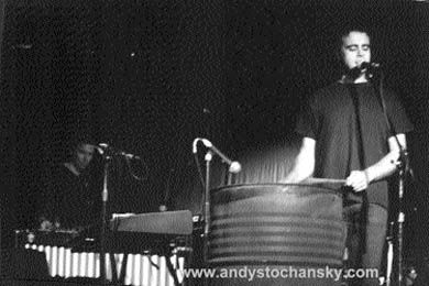 Andy Stochansky playing an oil drum.