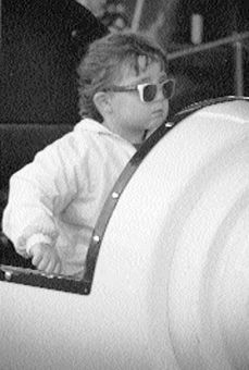 This youngster enjoys the view of the Kingston Exhibition through some great shades.