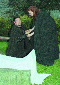 Richard III (Tyler Murree) pleads before Lady Anne (Carly Jones) at the foot of her husband's corpse.