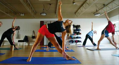 Yoga is just one of the many group exercise options available to help you get serious—and social—about your back-to-school workout routine.