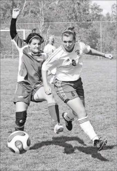 Katie Dalziel (8) goes for the ball Sunday against the Laurentian Voyageurs.