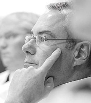Insp. Brian Cookman listens at the Police Services meeting yesterday.