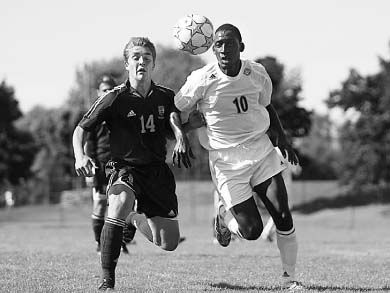 Mike Arnold (14) chases the ball in the Gaels' game against Nipissing Sunday.